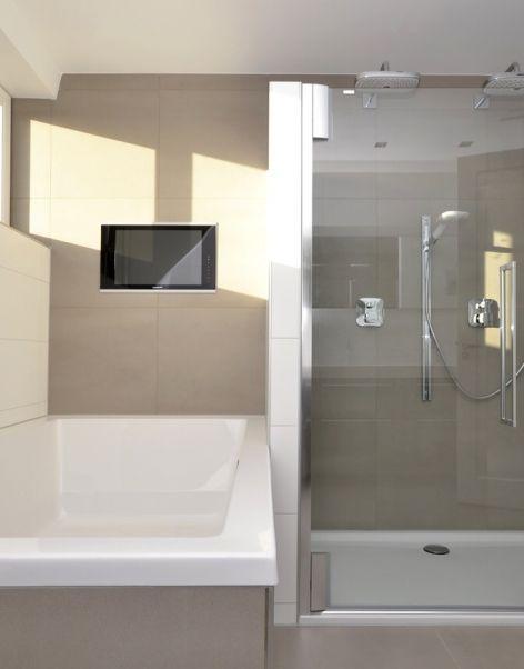 Het bad is mooi strak betegeld met zandkleurige tegels van 60x 60 cm. Daarbij kan je ook een mooie film kijken terwijl u in bad ligt. De douche is voorzien van twee douche koppen en een handdouche, ook is er een zitbankje gemaakt in de douche zodat je relax kan zitten tijdens het douchen.#design #inspiration #bathroom #shower #badkamer #bath #hotbath #porcelanosa #gjmeijer #meijer #tegels #tiles