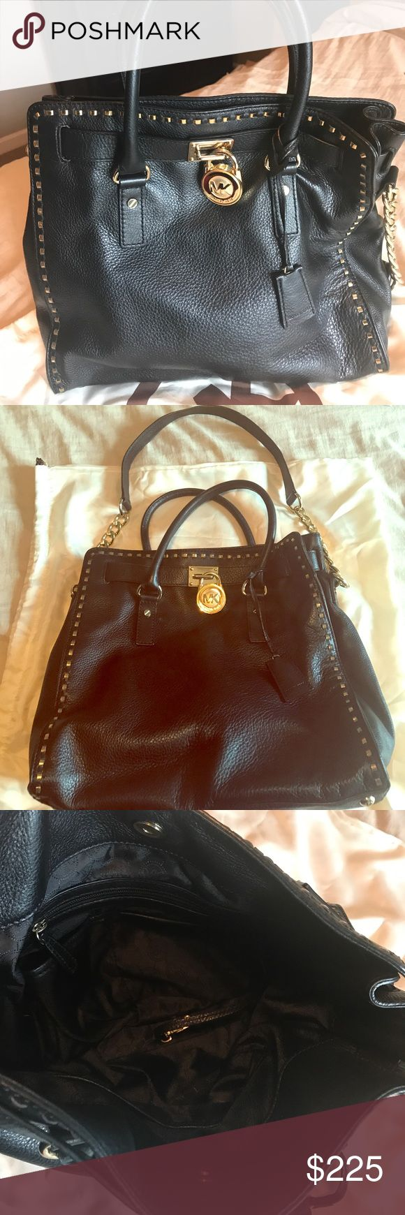 Michael Kors Hamilton tote Michael Kors Hamilton tote. Great condition. Black and gold. Short and long handles. Michael Kors Bags Totes