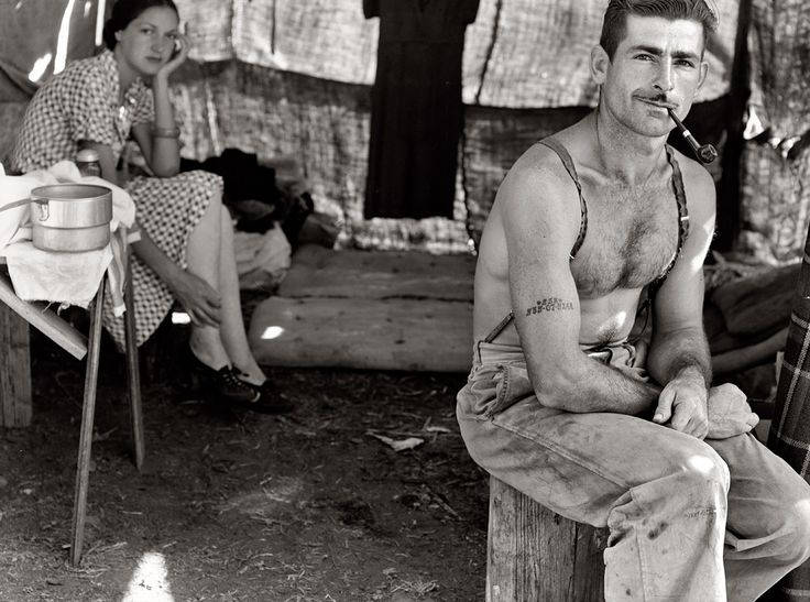 "Dorothea Lange - Oregon, August 1939. ""Unemployed lumber worker goes with his wife to the bean harvest. Note Social Security number tattooed on arm."