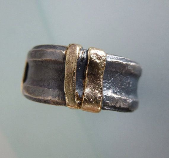 ```````One of a kind Ring for men```````    Oxidized Sterling SIlver Ring with 9K gold strips.    This rings rough and rustic style opened a door to me,