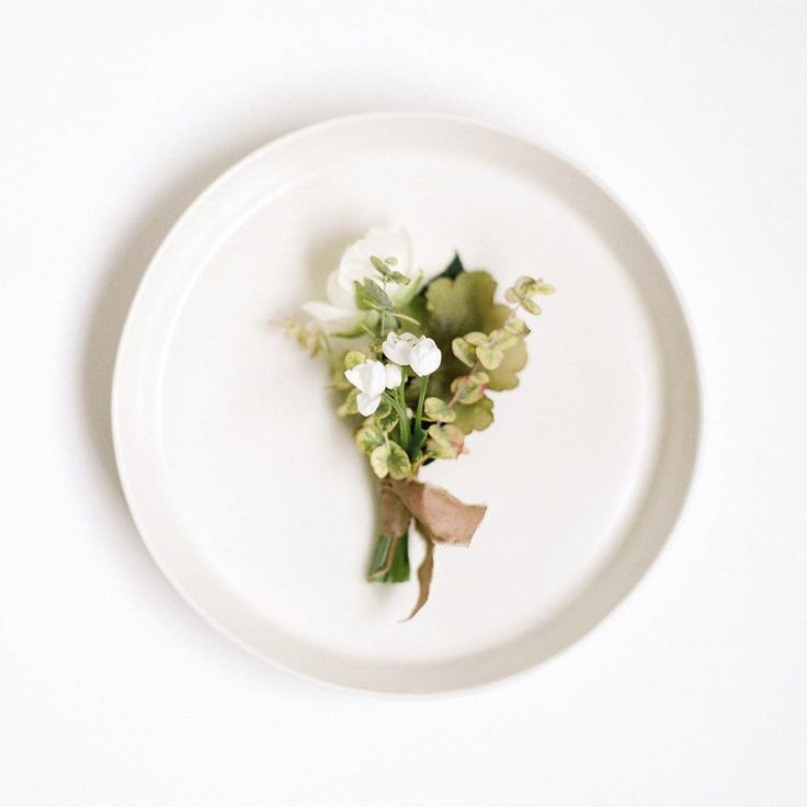 textural boutonniere with green and white blooms   photo by Heather Nan