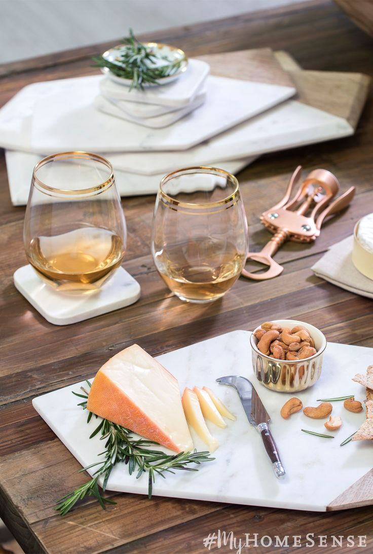 Is there anything better than a wine and cheese night? Glam up a night at home with marble serveware. Stemless wine glasses with gold detailing will work beautifully throughout the holiday season.