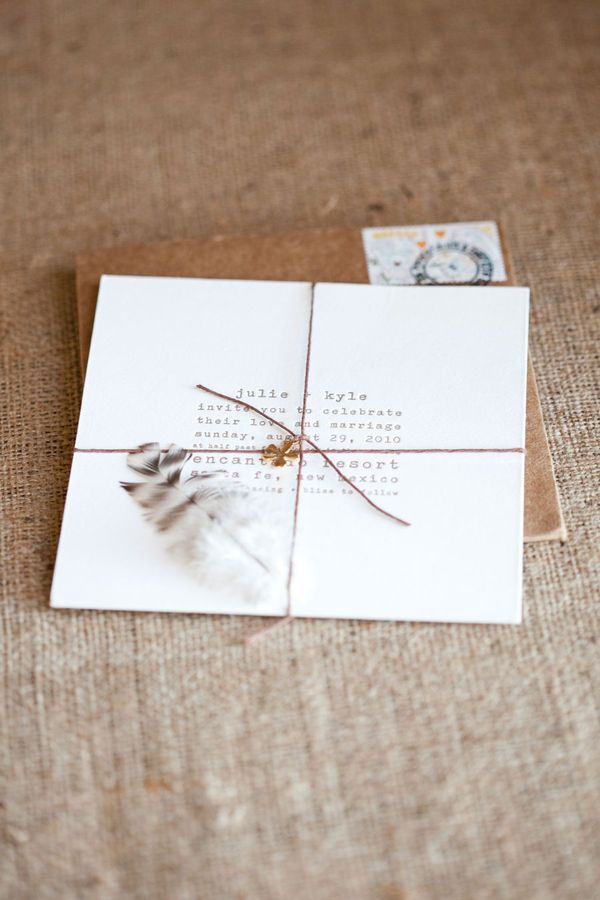White invite with brown Kraft envelope & cute charm could be added to the twine
