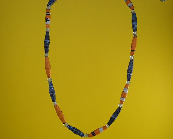 Blue and yellow paper beaded necklace.  The colors are one of my favorite things about this necklace. It features beautiful blue, black, yellow and white paper beads and li... #jewellry #jewelery #bohemian #boho #accessories