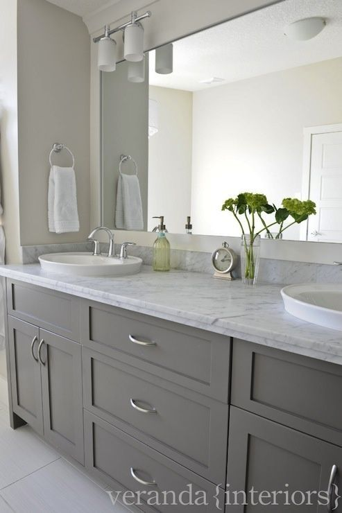 gray double bathroom vanity, shaker cabinets, frameless mirror, white oval vessel sinks, marble countertop.