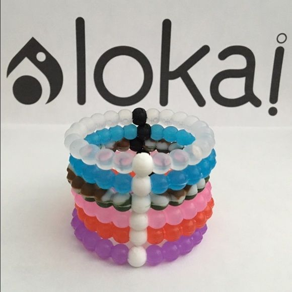 $10 for 1 Lokai Bracelet - Any Color - Any Size This listing is for 1 Lokai Bracelet. Each Lokai is infused with elements from the highest and lowest points on Earth. The bracelet's white bead carries water from Mt. Everest, and its black bead contains mud from the Dead Sea. Package will come with your choice of any  Lokai Bracelet. Please leave me a comment with the color and size you need. If you need more Lokai Bracelets send me a comment and let me know what you need. I will make you a…