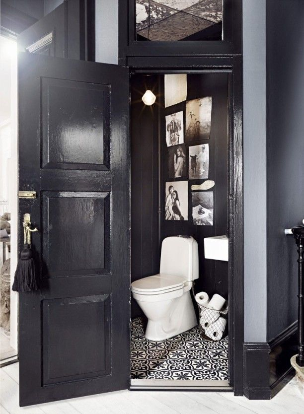 Marie Olsson Nylander's Cozy Swedish Home - I die for little powder rooms with tiny corner sinks. I love that even though the space is small the walls are black!