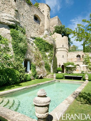 This ivy-covered castle in Provence underwent a decade-long renovation by the American owners and their French designer, Michel Biehn. Built in the 11th century as a tower for soldiers and significantly damaged by a fire in the 18th century, its new residents and their team had the challenge of restoring the building while staying as faithful to its original form as possible. Biehn made the pool an organic extension of the property by mimicking the structure's texture and colo