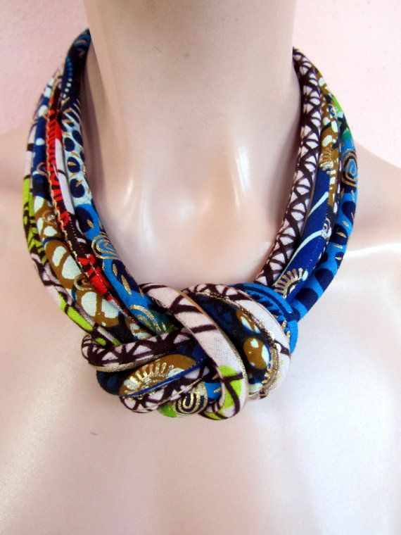 This an interesting  Show Stopper necklace made from four tubes sewn stuffed and assembled with a central knot. The colors are stunning and the golden