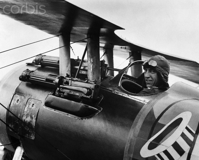"""Eddie Rickenbacker Sitting in Biplane - PG10417 - Rights Managed - Stock Photo - Corbis. World War I fighter pilot Eddie Rickenbacker, known as the """"ace of aces"""", sits in his Spad XIII fighter plane."""