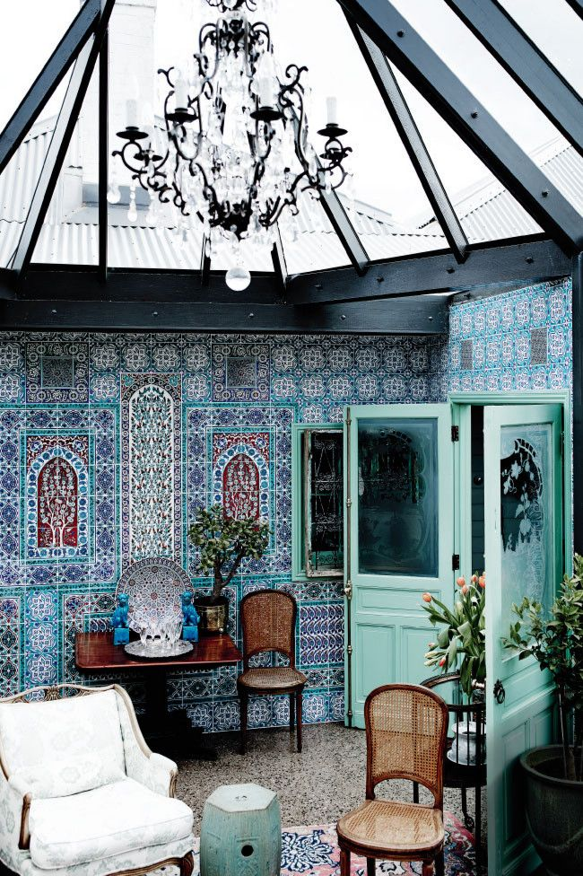 Charming Cottage in Daylesford, Victoria. Conservatory with its Turkish tiled walls, Regency side table and 1920s rattan chairs.