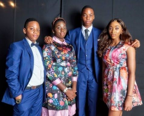 Pictured are socialite Sade Okoya's four children with her husband billionaire Nigerian businessman Razaq Okoya. They attended the Ovation Red Carol together