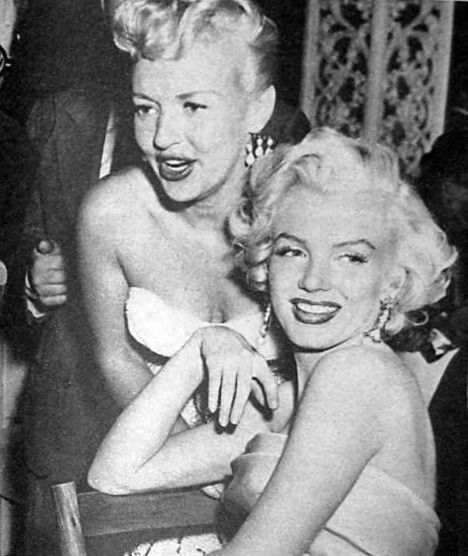 Marilyn and Betty Grable at Walter Winchell's birthday party at Ciro's, 13 May 1953.