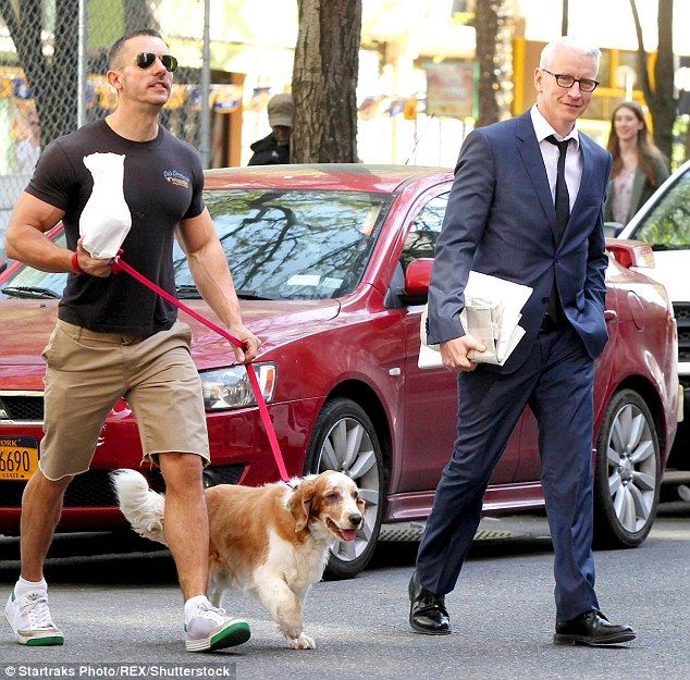 Cooper and his longtime partner Benjamin Maisani pictured above walking Molly in New York City in 2013