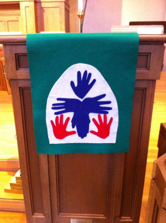 Lectern parament of the Presbyterian Church (USA) seal, using handprints from our Sunday School children. Materials: felt, iron-on webbing