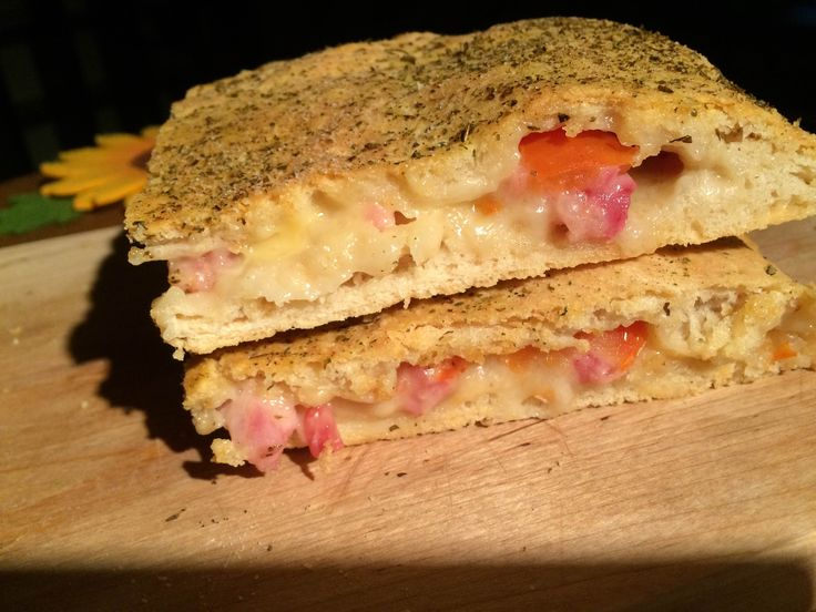 Here's Stuffed focaccia recipe with ham and mozzarella! Eat it hot...but be careful!
