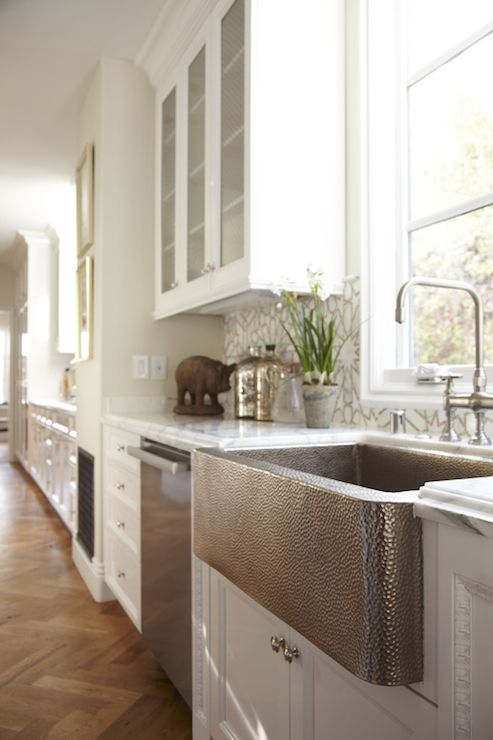 Hammered apron sink | OXA Architecture