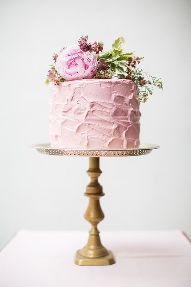 pink soft iced cake with florals | Read more on http://onefabday.com/pink-green-black-gold-wedding-table/