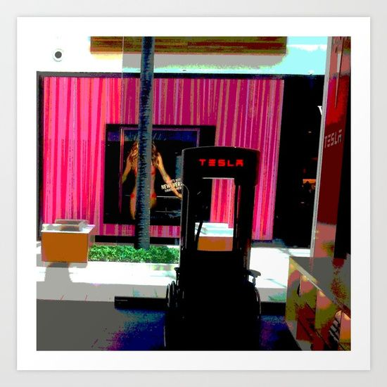 This image is an original photograph of the view from an electric car showroom. We see a wheelchair parked in front of a car charging station which has a view of a lingerie store across the walkway with a lingerie model poster and a hot pink curtain.