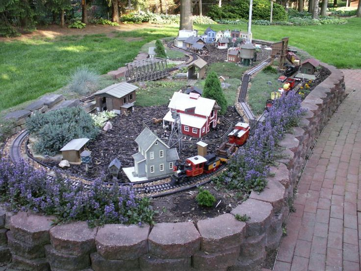 Garden Railroad built in a Flagstone Planter, Unknown Location. #Gardening #GardenRailroad