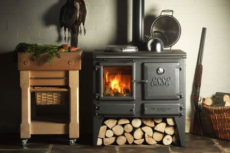 This looks to be a wonderful stove.  It has a water jacket on the back and would look good almost anywhere not just the kitchen