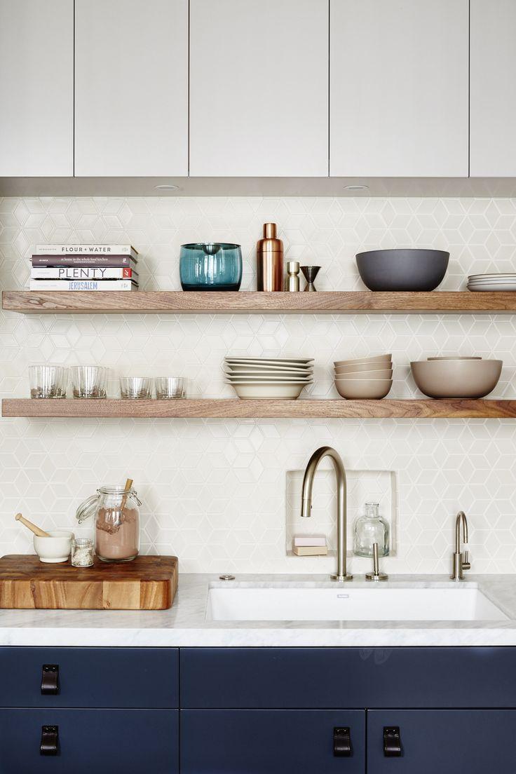 open shelving in kitchen // white backsplash // navy lower cabinets // white upper cabinets // white countertops