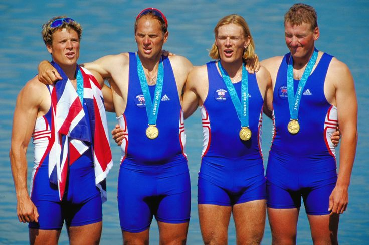 Team GB's James Cracknell, Steve Redgrave, Tim Foster and Matthew Pinsent celebrate gold in the Men's Coxless Four Rowing Final at the Sydney 2000 Olympic Games in Sydney.