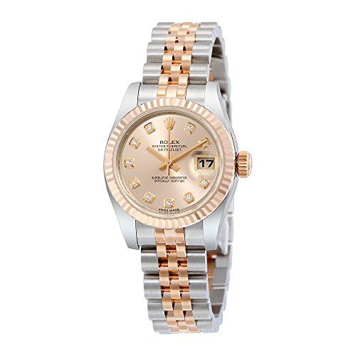 Stainless steel case with a stainless steel bracelet with 18kt rose gold center links. Fluted 18kt rose gold bezel. Pink dial with rose-gold tone hands and diamond hour markers. Dial Type: Analog. Dat...