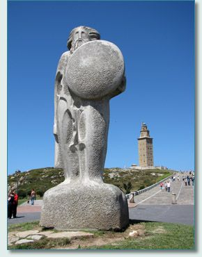 Celtic Chief Breoghan statue and Lighthouse at La Coruna, Galicia, Spain