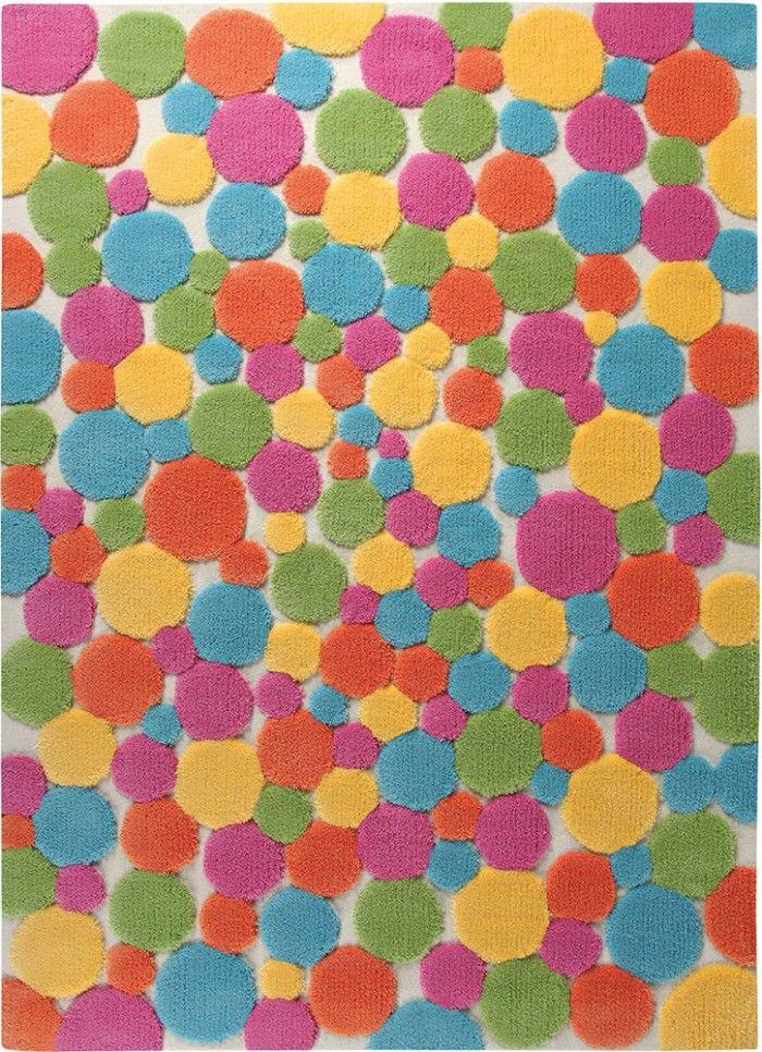 Ein kunterbunter Teppich mit besonderer Optik! Jeder einzelen farbige Punkt ist durch das spezielle Garn erhaben über dem Fond des Teppichs handgetuftet. Ein Teppich der mit fröhlichen Farben gute Laune verbreitet!
