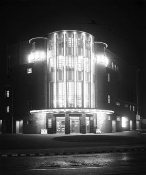 Art Deco cinema building with high curved facade, lit up at night, wavertree, 1939, uk