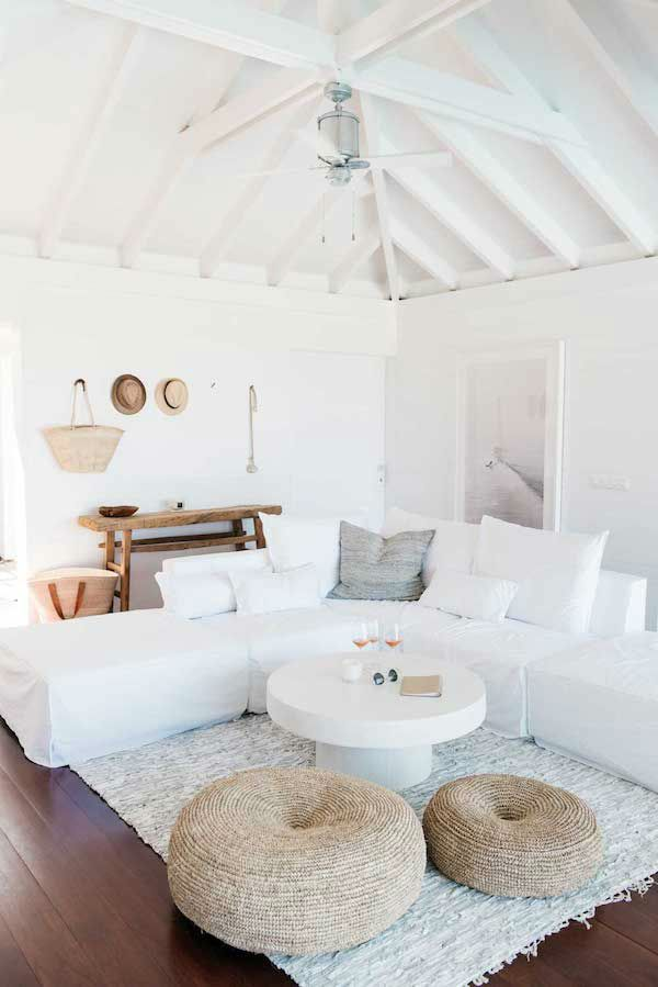 Nice living room idea with white couch and round white coffee table