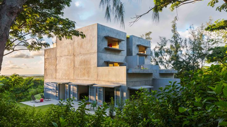 Six apartments stacked in pairs of rectangular concrete blocks make up this Caribbean guesthouse, designed by architect John Hix.