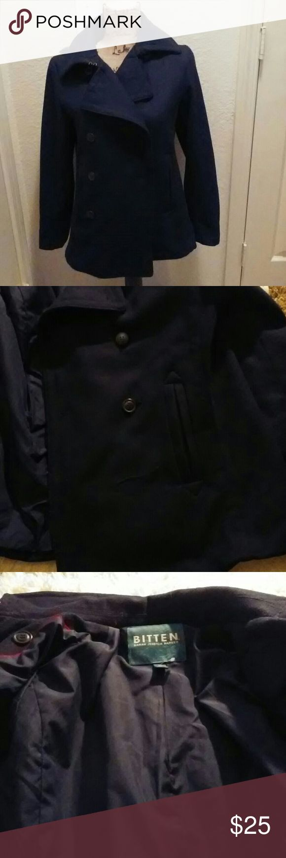 Bitten Sarah Jessica Parker Navy Peacoat. Sz M This is a great coat in Pre-Loved condition. The coat has two loose buttons and one missing BUTTON. This is a simple fix. There are additional buttons that are on the interior of the coat to replace the missing button. Other than the buttons there are no signs of wear. Retails for $75. This is a great coat at an amazing price. BITTEN Sarah Jessica Parker Jackets & Coats Pea Coats