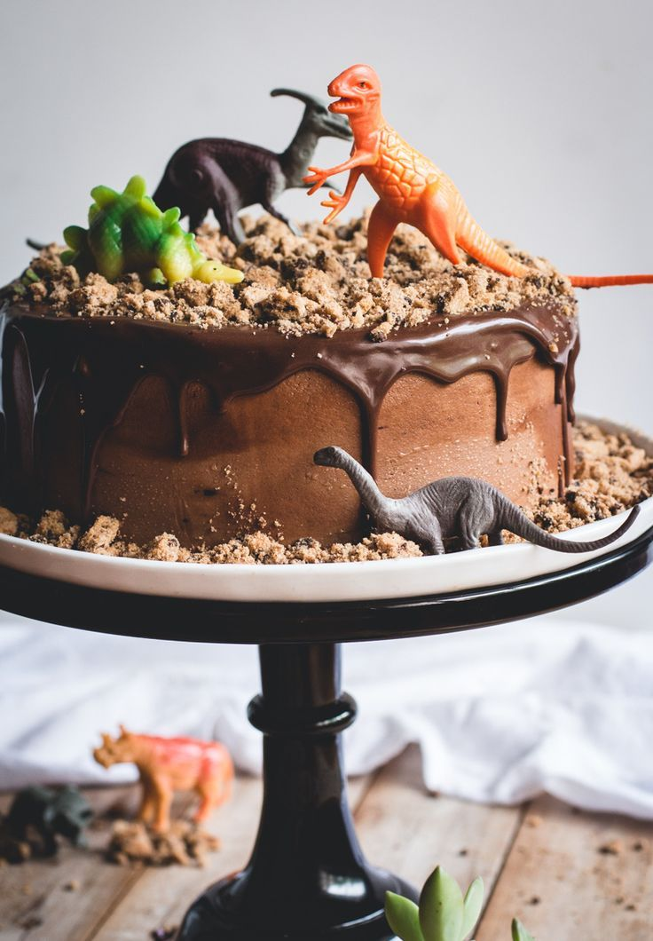 """We love this Chocolate Chips Ahoy Dinosaur Cake, complete with cookie """"dirt."""" Fun cake idea for a dinosaur-themed birthday party."""