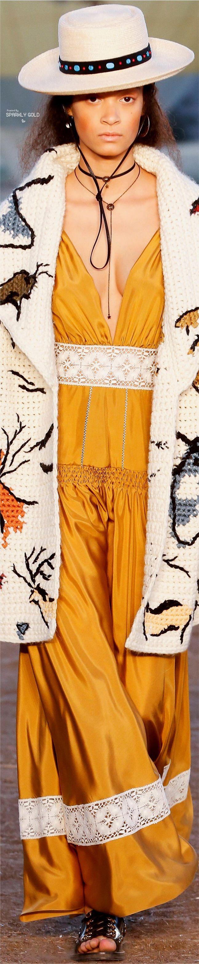 Christian Dior R-18: hat, long crochet cardigan, mustard maxi dress.