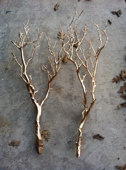 gold branch place cards - just add the names!  Or...if one is feelng crafty...prune a shrub, stick branches in styrofoam, spray with gold metallic paint and Bingo...saved yourself a bundle!