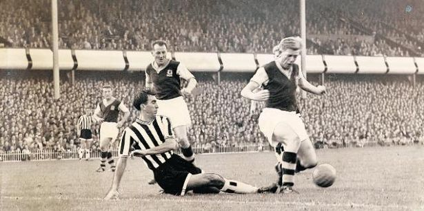 4th October 1958. Aston Villa centre forward Gerry Hitchens shields the ball from Newcastle United centre half Bob Stokoe.