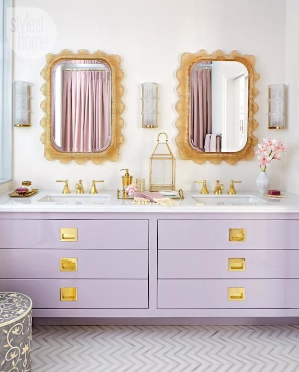 bathroom with lavender vanity // calacatta and thassos tiles in herringbone pattern // crystal and brass sconces
