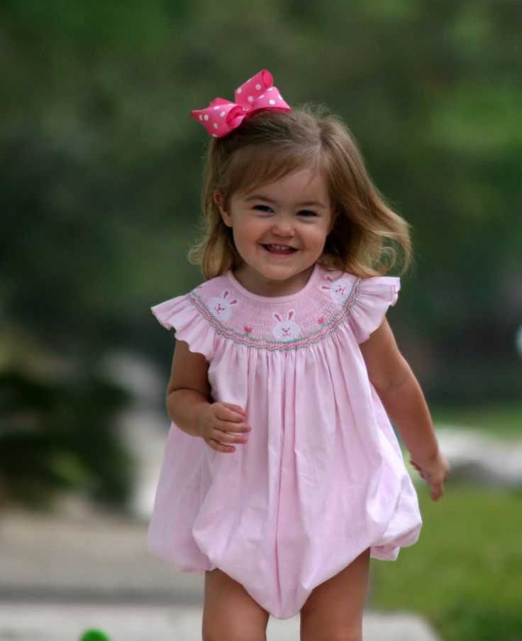little girls in bows and smocked clothing