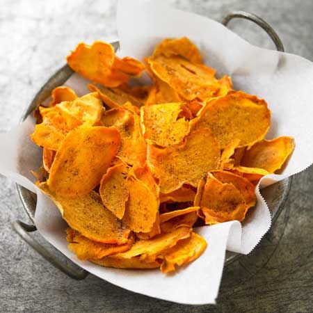 1 sweet potato1/2 teaspoon ground cumin1/4 teaspoon sugar1/4 teaspoon chili powder1/4 teaspoon salt. cook 375.Cut the potato into thin slices. Spray baking sheet, arrange slices in a single layer, lightly coat with cooking spray. Bake for 7 minutes@375. turn and bake 7-10 more minutes. Meanwhile, in a small bowl, combine cumin, sugar, chili powder,salt. Pour over chips, toss well, serve.