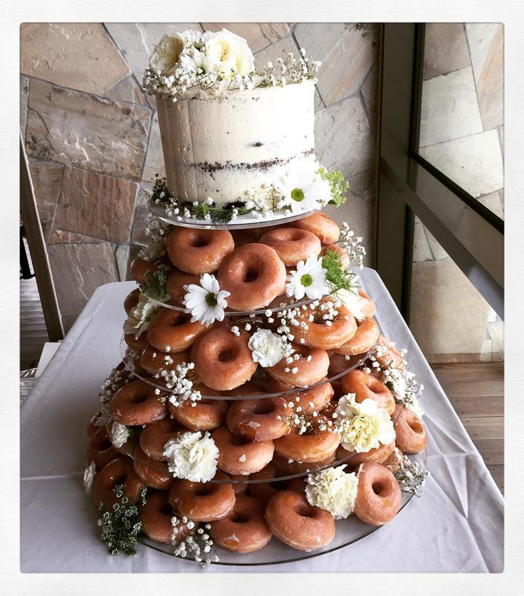 """I loved setting up this Krispy Kreme creation! Naked cake on top with 120…"