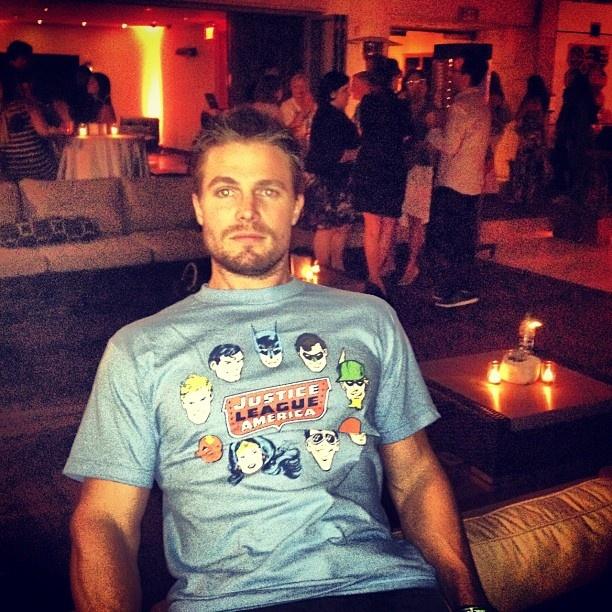 Stephen Amell aka Green Arrow rockin' a Justice League shirt