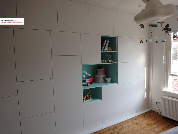 Storage unit with variable divisions of doors and  open spaces by www.myhouse-amsterdam.nl