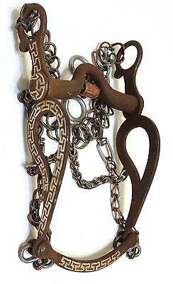 Authentic Rustic Charro Bit with copper roller and is one of kind horse bit. Includes a complete set of cadenilla chains. Rodillos de cobre, y esta Auténtica Rustico Freno Charro es especial. Incluye