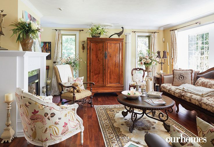 """A clever mix of patterns, colour and personality make this a cheerful living room. Pale yellow walls and antiques are pretty with greenery and flowers.    See more of this home in """"Elora Homeowners Add Character in Spades"""" from OUR HOMES Wellington-Dufferin Summer 2017: http://www.ourhomes.ca/articles/build/article/elora-homeowners-add-character-in-spades"""