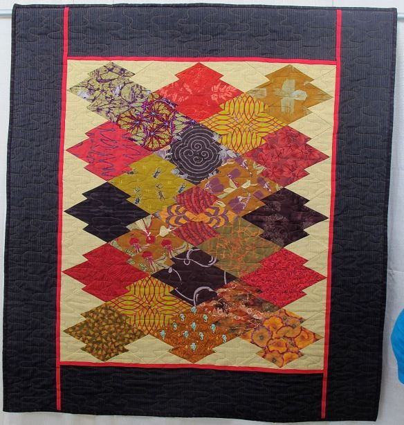 Japanese Eggplant by Susan Lambert, quilted by New Pieces, photo by The Plaid Portico
