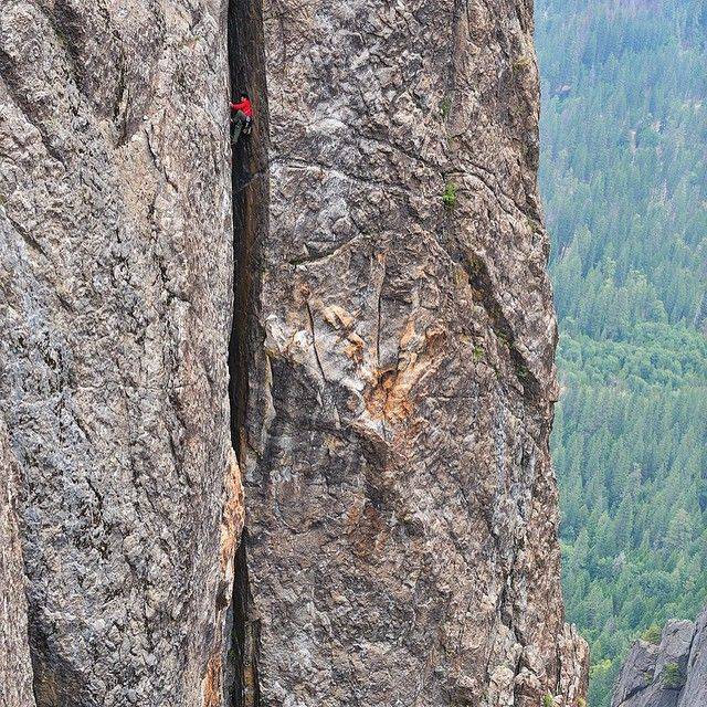 "Keith Ladzinski: ""There's no valley in the world like Yosemite Valley. You can't help but feel small under the 3,000+ granite cliffs. In June of 2009 @rockandicemag sent me to Yosemite with @lizzyscully to shoot a story on moderate routes.[...] Finding this angle to shoot Lance Lemkau, seen here on ""The Sequel"", took a lot of scrambling and scouting. The route is on Higher Cathedral and is a crazy, obscure and nearly forgotten grovel chimney line on the side of the mountain."""