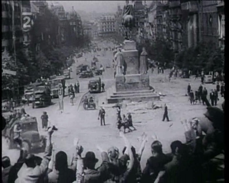 """Liberation of Prague. Still from documentary """"Selhání"""" (2000). Note the hammer and sickle (☭) graffiti on the pedestal of St. Wenceslas monument."""