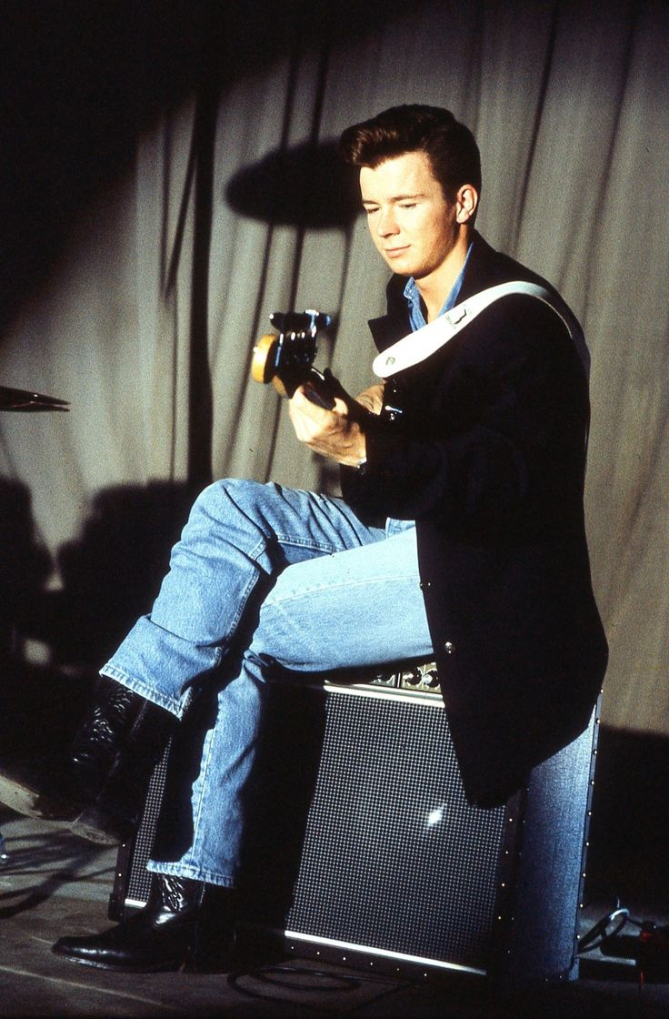 Rick Astley. Aww, I think he's kinda cute :)